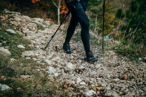Woman hiking in trail of stones